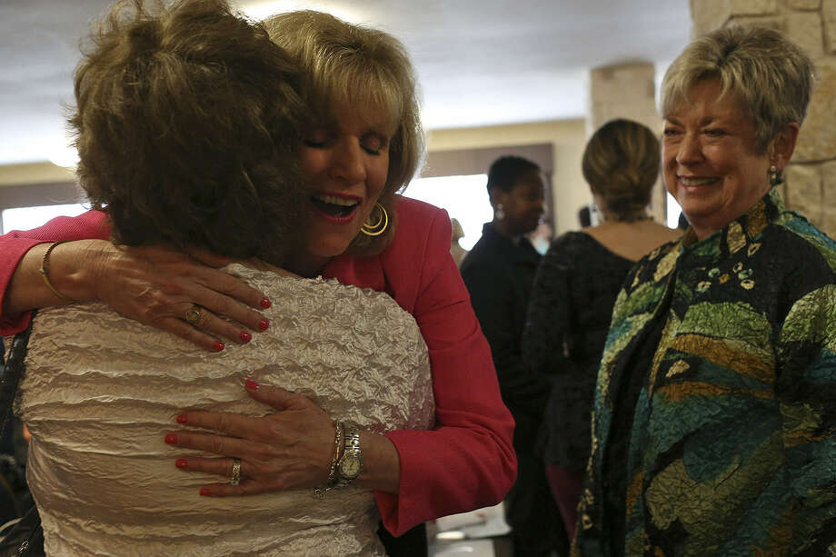 Lisa Burkhardt Worley, embracing a friend last week at a San Antonio Chapter of the Christian Women's Small Business Association luncheon, was San Antonio's first female sportscaster but now focuses on helping women with everyday struggles. Photo: Lisa Krantz / San Antonio Express-News