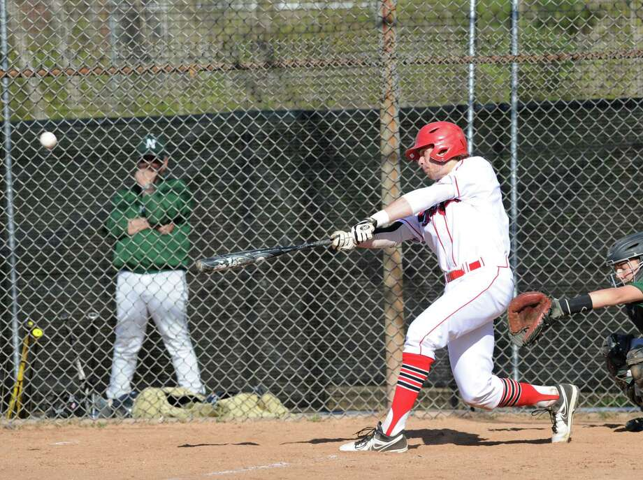 Taylor Olmstead of Greenwich belts a first-pitch three run homer in the bottom of the second inning of the high school baseball game between Greenwich High School and Norwalk High School at Greenwich, Friday afternoon, April 26, 2013. Photo: Bob Luckey / Greenwich Time