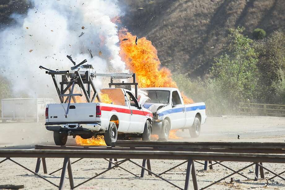 Things get a bit uncivil as two super-genius teams compete to invent a way to keep explosives from blowing up when two rigged trucks crash head-on. Photo: Gilles Mingasson, Discovery Channel