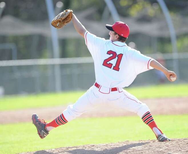 Greenwich pitcher J.T. Hintzen throws during high school baseball game between Greenwich High School