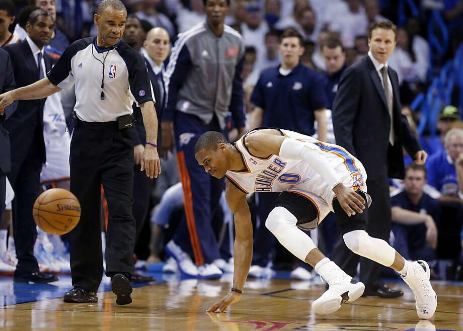Russell Westbrook stumbles after injuring his knee during the Thunder's game Wednesday. Photo: Sue Ogrocki, Associated Press