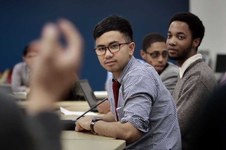 Lou Alvin Cayabyab and Devante Tillis, (right) listen to fellow students sharing their ideas at the year up training program in downtown San Francisco, Calif. on Wednesday April 24, 2013. They are currently enrolled in internship programs with local companies, Cayabyab with Twitter and Tillis with salesforce. The city run program is designed to train local workers for technology jobs.