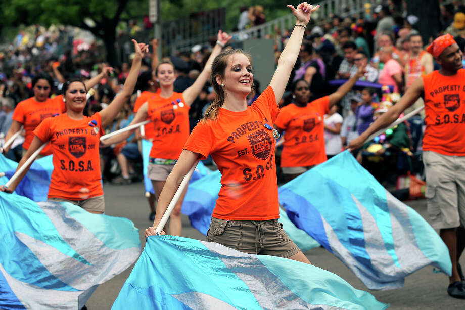 UTSA flags team members march through Alamo Plaza as the Battle of Flowers Parade moves through the downtown area  on  April 26 2013. Photo: TOM REEL