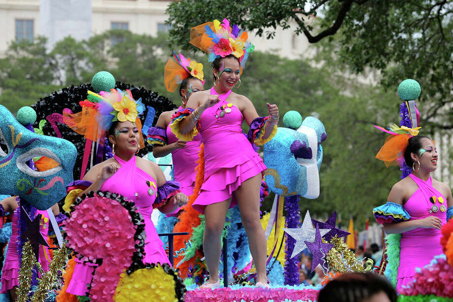 Edison High School performers ride the Rio Carnival float in front of the Alamo as the Battle of Flowers Parade moves through the downtown area  on  April 26 2013. Photo: TOM REEL