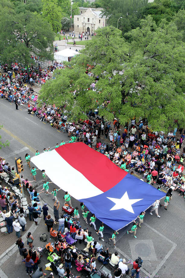 Spectators fill Alamo Plaza as the Battle of Flowers Parade moves through the downtown area  on  April 26 2013. Photo: TOM REEL