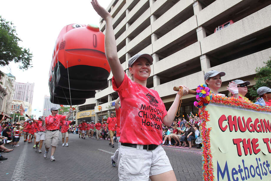 The Methodist Children's Hospital contingent walks down Commerce as the Battle of Flowers Parade moves through the downtown area  on  April 26 2013. Photo: TOM REEL