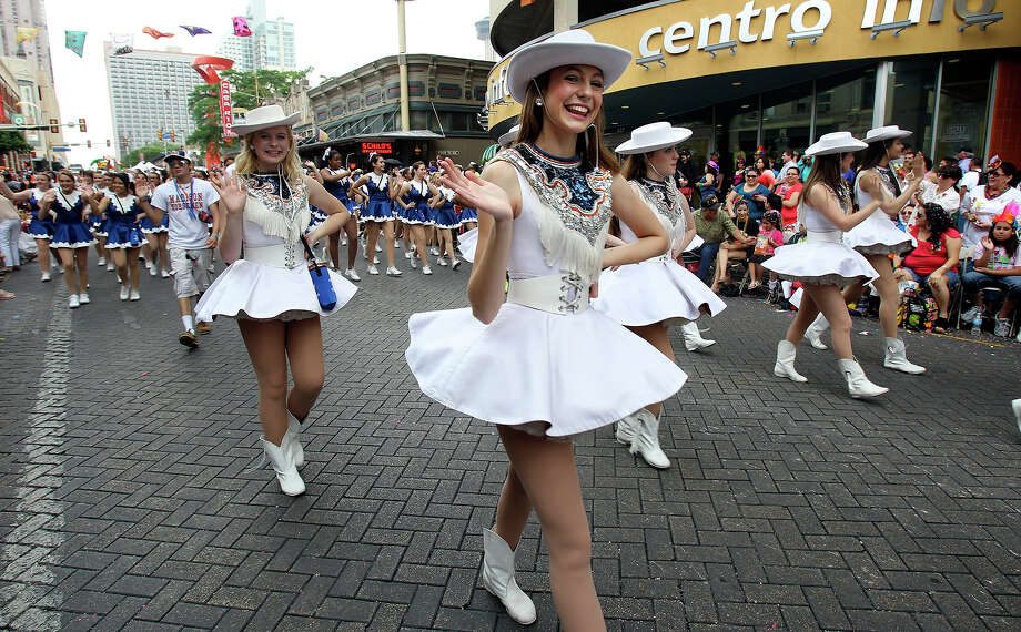 Madison High School dancers  turn on to Commerce Street as the Battle of Flowers Parade moves through the downtown area  on  April 26, 2013. Photo: TOM REEL
