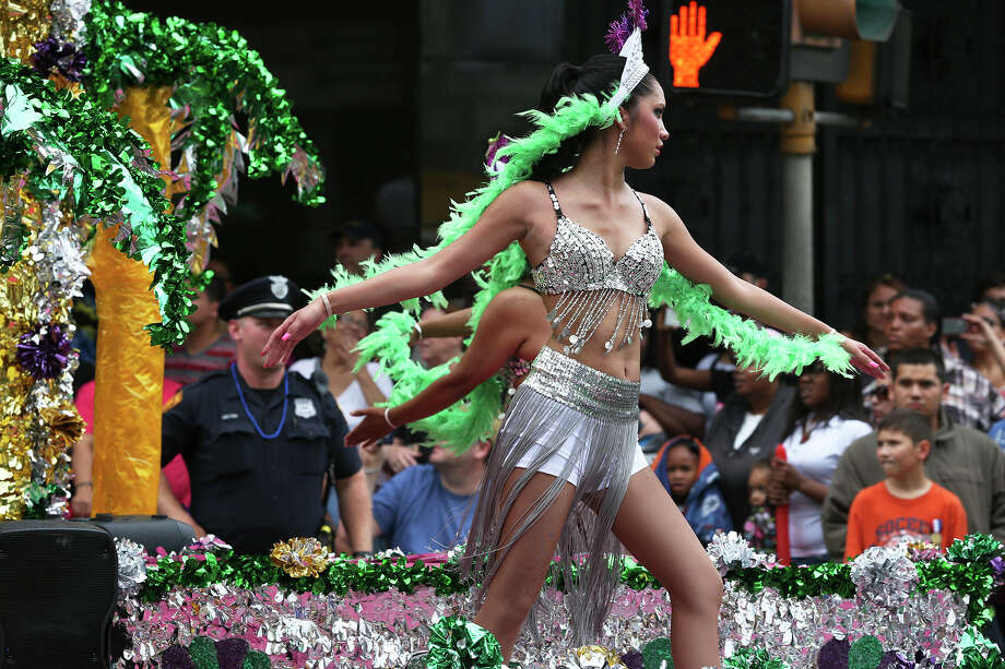 A dancer with the Image Dance Company performs as the Battle of Flowers Parade moves through the downtown area  on  April 26 2013. Photo: TOM REEL