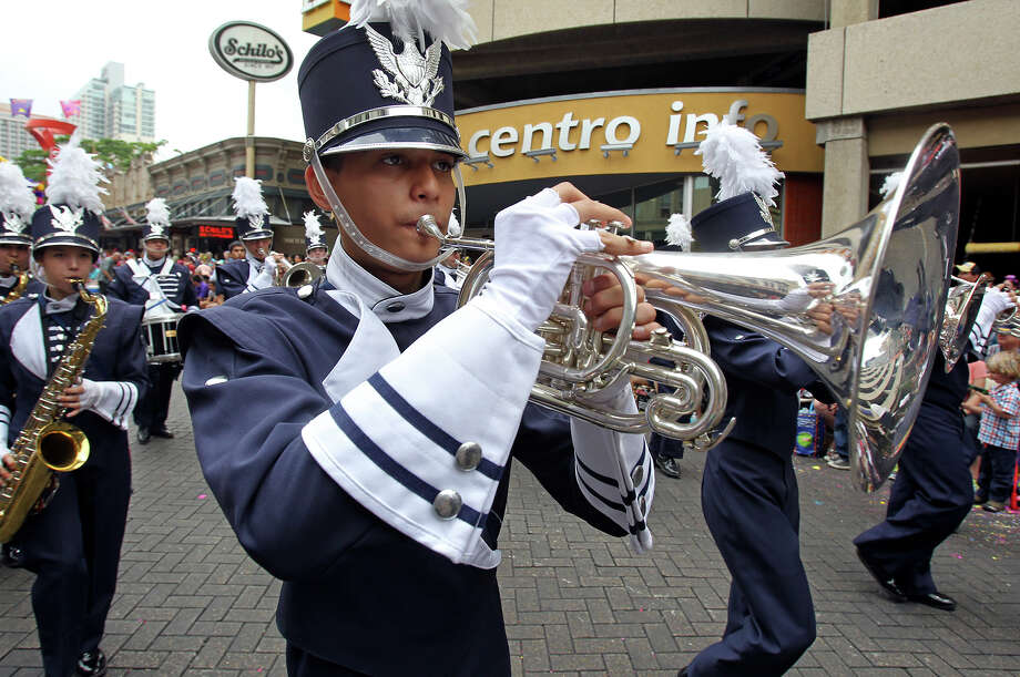 The Central Catholic band moves along Commerce street as the Battle of Flowers Parade moves through the downtown area  on  April 26 2013. Photo: TOM REEL