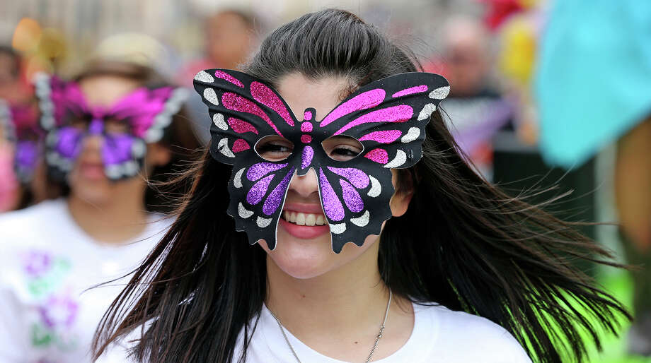 A Burbank High School student enjoys the crowd in Alamo Plaza as the Battle of Flowers Parade moves through the downtown area  on  April 26 2013. Photo: TOM REEL