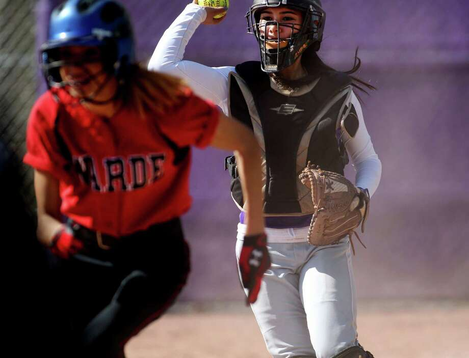 Weshill Viking catcher Brittany Batista tosses to third base to catch a Fairfield Warde player in a run down in a softball game in Stamford, Conn. Friday, April 26, 2013. Westhill went on to win the game, 11-3. Photo: J. Gregory Raymond / Stamford Advocate Freelance;  © J. Gregory Raymond