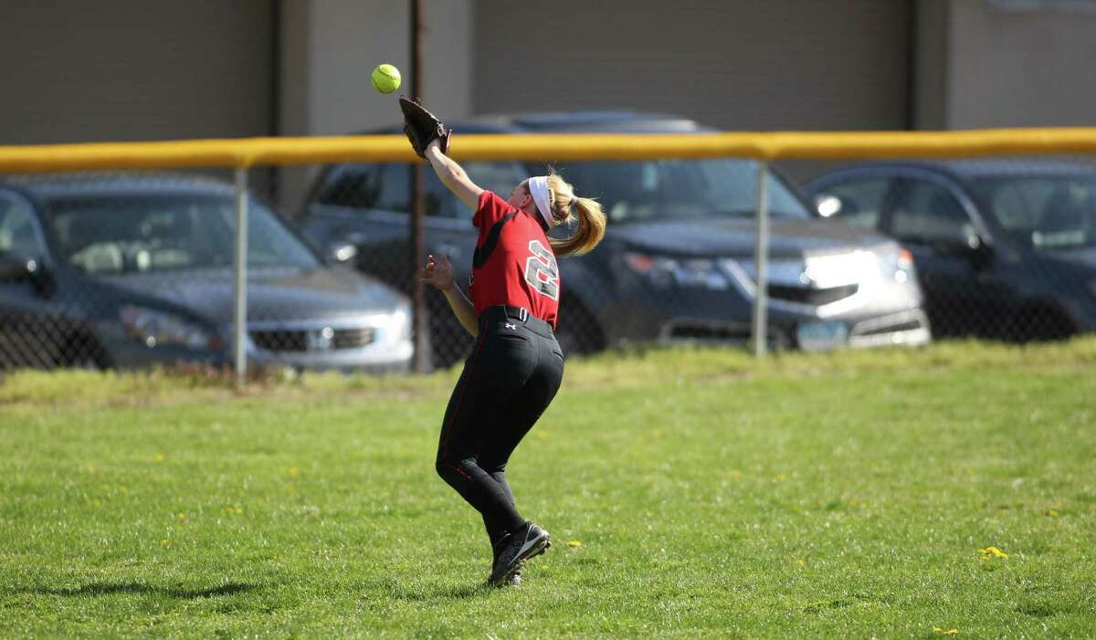 Fairfield Warde leftfielder Brianna West can't handle a fly ball as the Westhill girls softball team went on to post an 11-3 win in Stamford, Conn. on Friday April, 26, 2013.