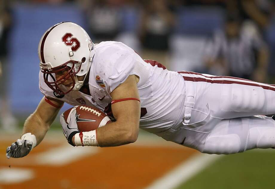 Zach ErtzThe tight end for the Philadelphia Eagles was drafted in the second round of the 2013 NFL draft while he was playing collect football at Stanford. Here Ertz dives into the end zone for a third quarter touchdown against the Oklahoma State Cowboys at the Fiesta Bowl game in Glendale, Ariz. on Monday, Jan. 2, 2012. Photo: Paul Chinn, The Chronicle