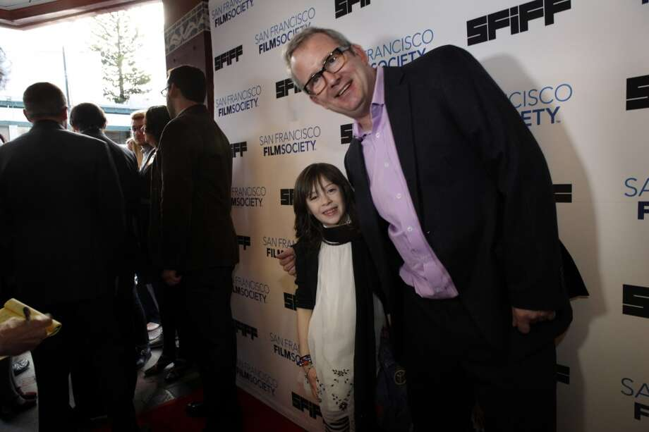 "Onata Aprile, the star of the film, ""What Maisie Knew,"" poses with Ted Hope on the red carpet at the Castro Theater for the 56th San Francisco International Film Festival in San Francisco, Calif., on Thursday, April 25 2013."