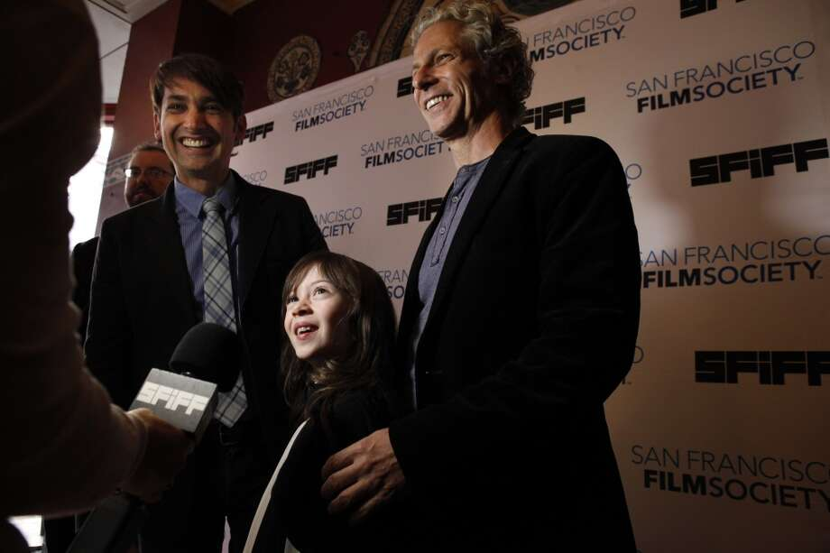 "Onata Aprile, center, the star of the film, ""What Maisie Knew,"" and the film's two directors, Scott McGehee, left, and David Siegel, right, speak to the media on the red carpet at the Castro Theater for the 56th San Francisco International Film Festival in San Francisco, Calif., on Thursday, April 25 2013."