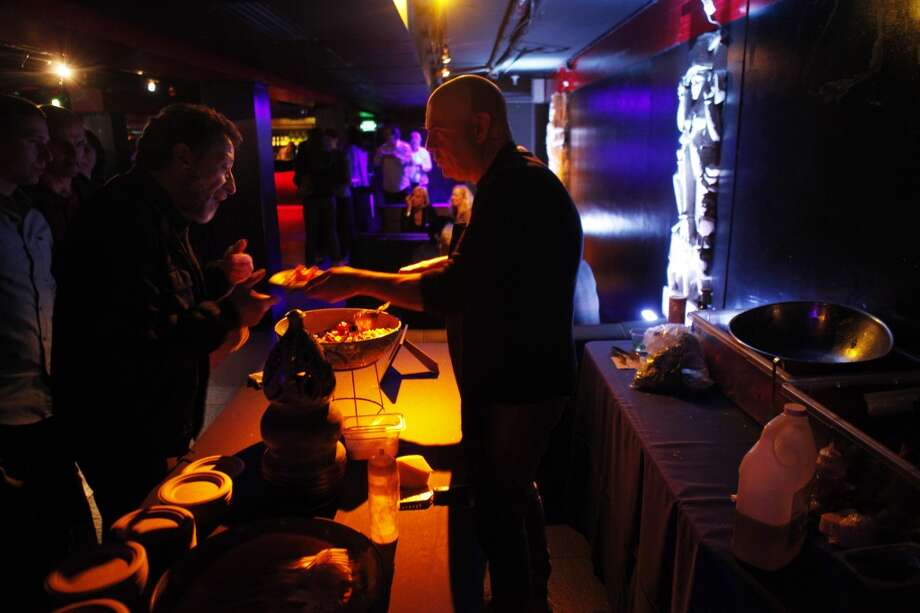 Joseph Manzare of Globe Restaurant serves some food to guests at the 56th San Francisco International Film Festival opening night party at Temple Nightclub in San Francisco, Calif., on Thursday, April 25 2013.