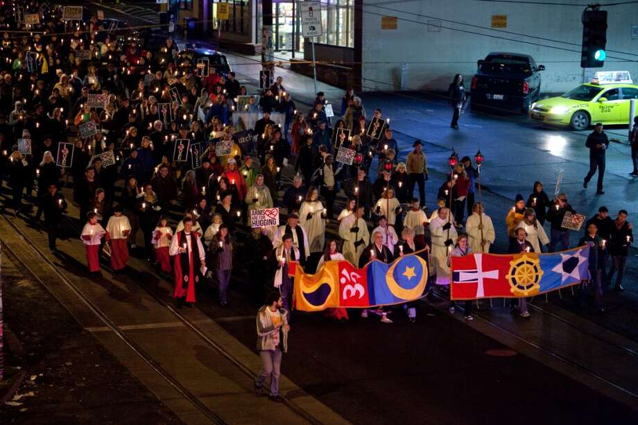People march along Broadway during an interfaith vigil and march against gun violence on Saturday, February 9, 2013 in Seattle. Hundreds of people marched with candles from St. Marks Episcopal Cathedral, through Capitol Hill and eventually to St. James Catholic Cathedral. (Joshua Trujillo, seattlepi.com) Photo: SEATTLEPI.COM