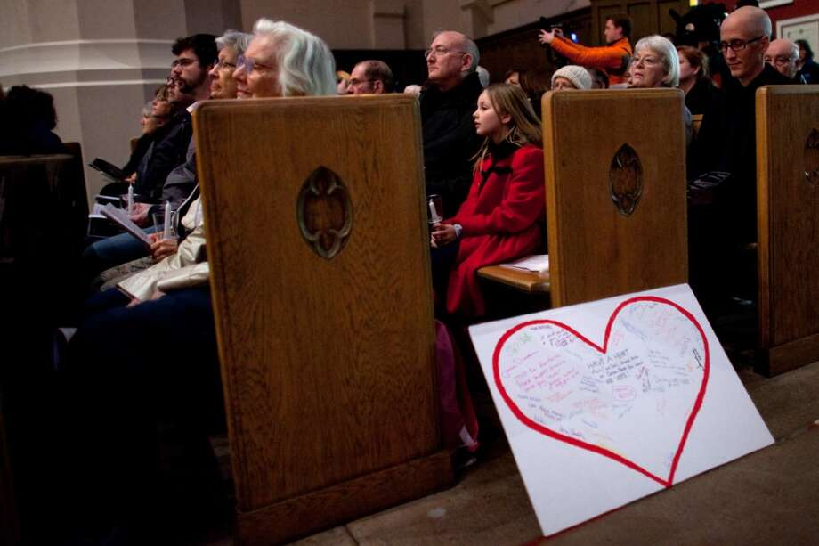 A sign rests against a pew at St. Marks Cathedral during an interfaith vigil and march against gun violence on Saturday, February 9, 2013 in Seattle. Hundreds of people marched with candles from St. Marks Episcopal Cathedral, through Capitol Hill and eventually to St. James Catholic Cathedral. (Joshua Trujillo, seattlepi.com) Photo: SEATTLEPI.COM