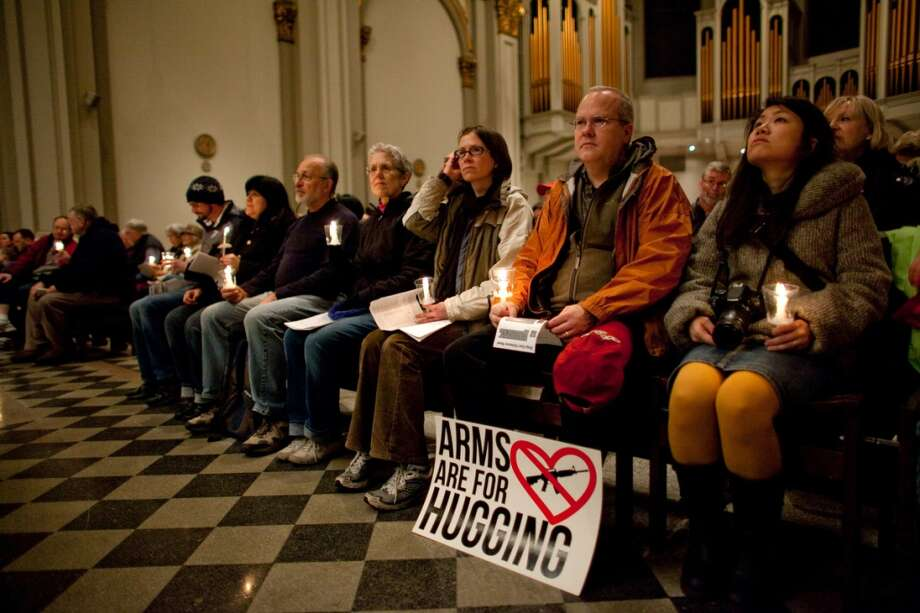 People listen in St. James Cathedral during an interfaith vigil and march against gun violence on Saturday, February 9, 2013 in Seattle. Hundreds of people marched with candles from St. Marks Episcopal Cathedral, through Capitol Hill and eventually to St. James Catholic Cathedral. (Joshua Trujillo, seattlepi.com) Photo: SEATTLEPI.COM