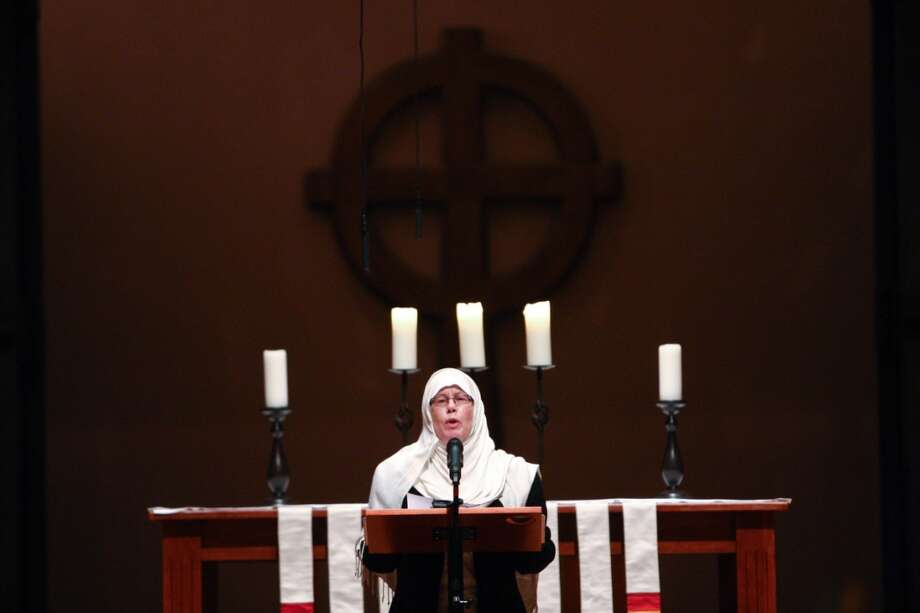 Janice Tufte speaks during an interfaith vigil and march against gun violence on Saturday, February 9, 2013 in Seattle. Hundreds of people marched with candles from St. Marks Episcopal Cathedral, through Capitol Hill and eventually to St. James Catholic Cathedral. (Joshua Trujillo, seattlepi.com) Photo: SEATTLEPI.COM