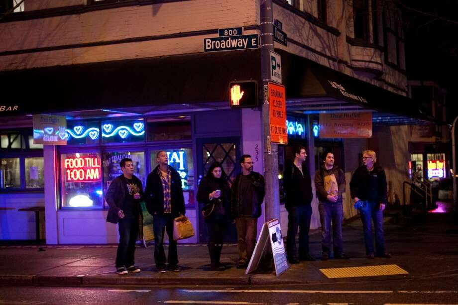 People on Broadway watch people march past during an interfaith vigil and march against gun violence on Saturday, February 9, 2013 in Seattle. Hundreds of people marched with candles from St. Marks Episcopal Cathedral, through Capitol Hill and eventually to St. James Catholic Cathedral. (Joshua Trujillo, seattlepi.com) Photo: SEATTLEPI.COM