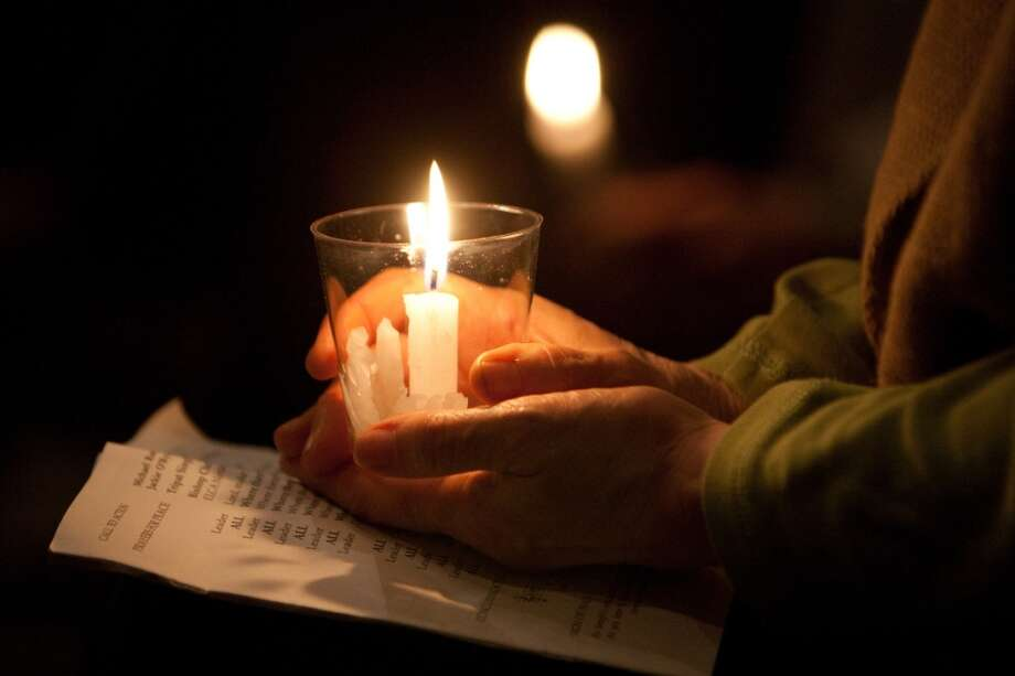 A participant holds a candle during an interfaith vigil and march against gun violence on Saturday, February 9, 2013 in Seattle. Hundreds of people marched with candles from St. Marks Episcopal Cathedral, through Capitol Hill and eventually to St. James Catholic Cathedral. (Joshua Trujillo, seattlepi.com) Photo: SEATTLEPI.COM