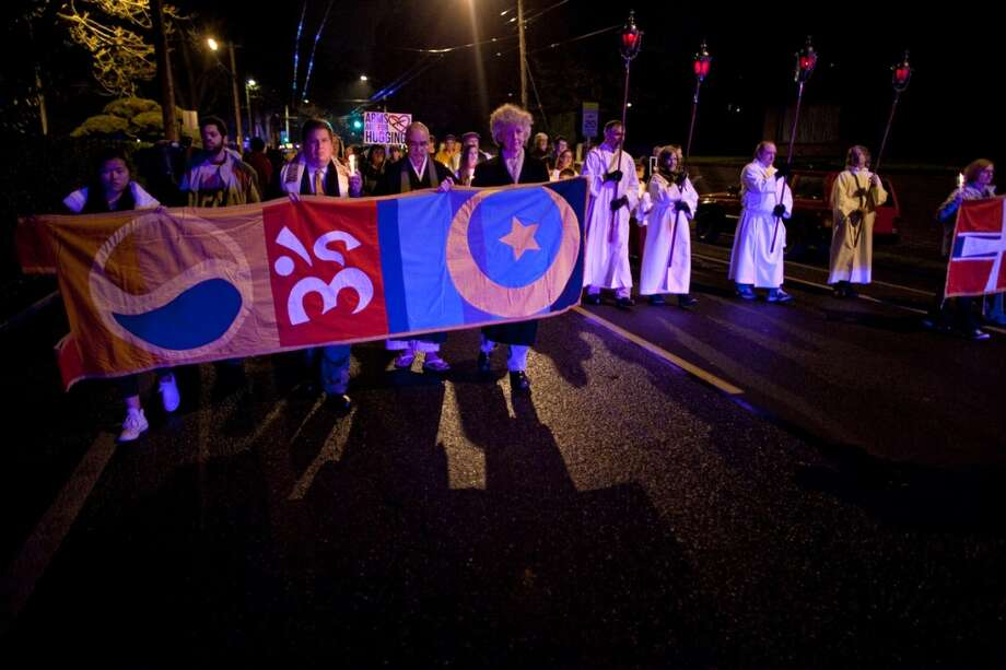 People march on 10th Avenue during an interfaith vigil and march against gun violence on Saturday, February 9, 2013 in Seattle. Hundreds of people marched with candles from St. Marks Episcopal Cathedral, through Capitol Hill and eventually to St. James Catholic Cathedral. (Joshua Trujillo, seattlepi.com) Photo: SEATTLEPI.COM