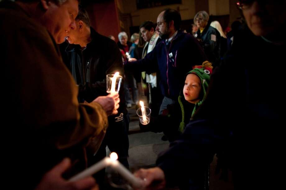 Franklin Heymann, 6, lights his candle during an interfaith vigil and march against gun violence on Saturday, February 9, 2013 in Seattle. Hundreds of people marched with candles from St. Marks Episcopal Cathedral, through Capitol Hill and eventually to St. James Catholic Cathedral. (Joshua Trujillo, seattlepi.com) Photo: SEATTLEPI.COM