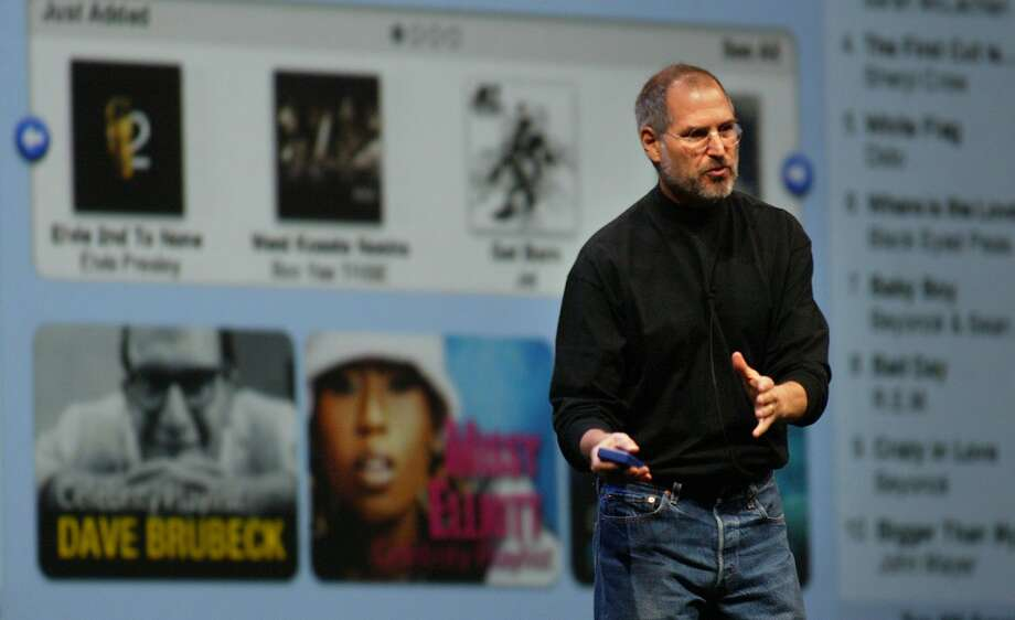 "APPLE_0245_fl.jpg; Apple Computer Steve Jobs unveiled  iTunes Music Store for Windows in SF. The company's Mac version of the downloadable music store caused a sensation in the music industry in April, and the company has sold more than 10 million songs. Apple bills Thursday's presentation as """"the year's biggest music storey is about to get even bigger.''Apple has also been stepping up advertising for its iPod digital music player.  FREDERIC LARSON / The Chronicle  MANDATORY CREDIT FOR PHOTOG AND SF CHRONICLE/NO SALES-MAGS OUT Photo: Frederic Larson, SFC"