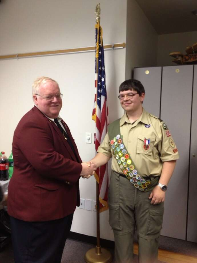 New Eagle Scout Kevin Matyi of Guilderland Boy Scout Troop #24, sponsored by Guilderland Elks Lodge #2480, is seen with Past Exalted Ruler Michael Hoffstetter. The ceremony was held Saturday April 20 at the Guilderland Public Library. (Michael Jones)
