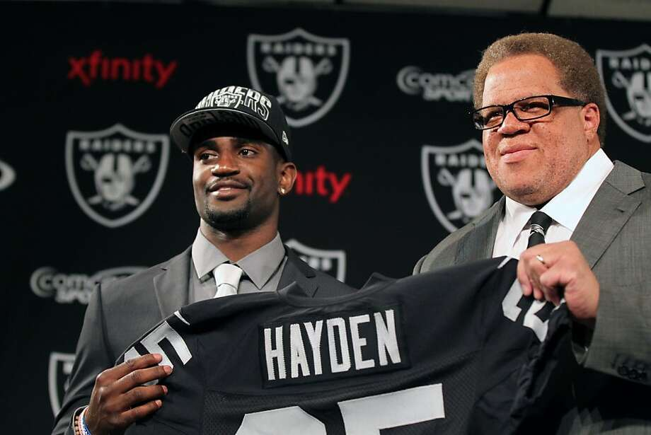 Reggie McKenzie (right) says he would have drafted D.J. Hayden third overall if the Raiders had not been able to trade down. Photo: Lance Iversen, The Chronicle