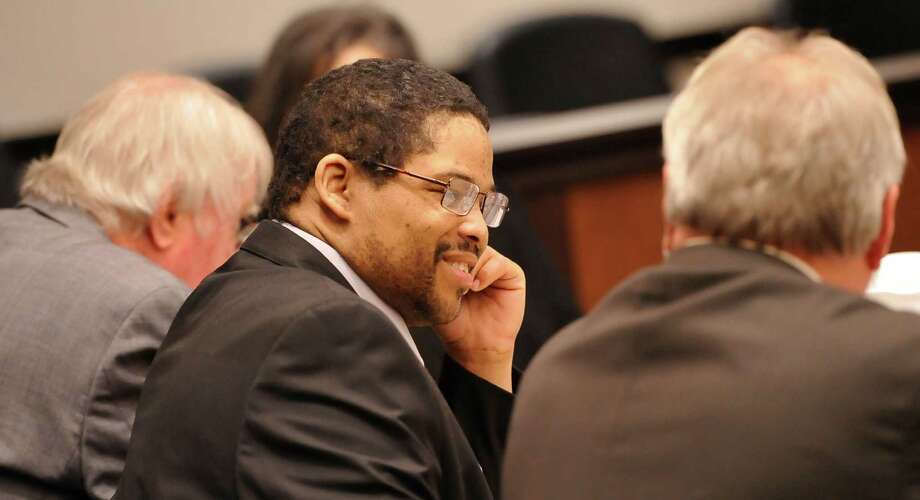 The defendant, Bartholomew Granger, center, speaks to his attorney James Makin, right, around 8:50 a.m. Monday morning before the start of his trial. Sonny Cribbs is on his left. Testimony has begun today in Galveston in the relocated capital murder trial of  Granger, who is on trial in the shooting death of Minnie Ray Sebolt, a 79-year-old Deweyville resident who was gunned down March 14, 2012, at the Jefferson County Courthouse. According to his indictment, Granger was trying to shoot a witness in an aggravated sexual assault trial in which he was the defendant and accidentally hit Sebolt. The crime is capital murder because Sebolt was killed in the commission of another crime, retaliation against a witness, according to the prosecution.    Dave Ryan/The Enterprise Photo: Dave Ryan