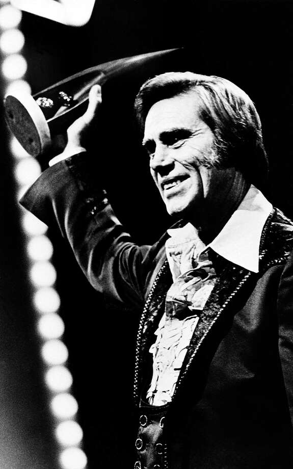 Singer George Jones accepts his 1980 award for best male vocalist at the Country Music Association (CMA) awards show in Nashville, Tenn., Oct. 13, 1981.  (AP Photo) / AP1981