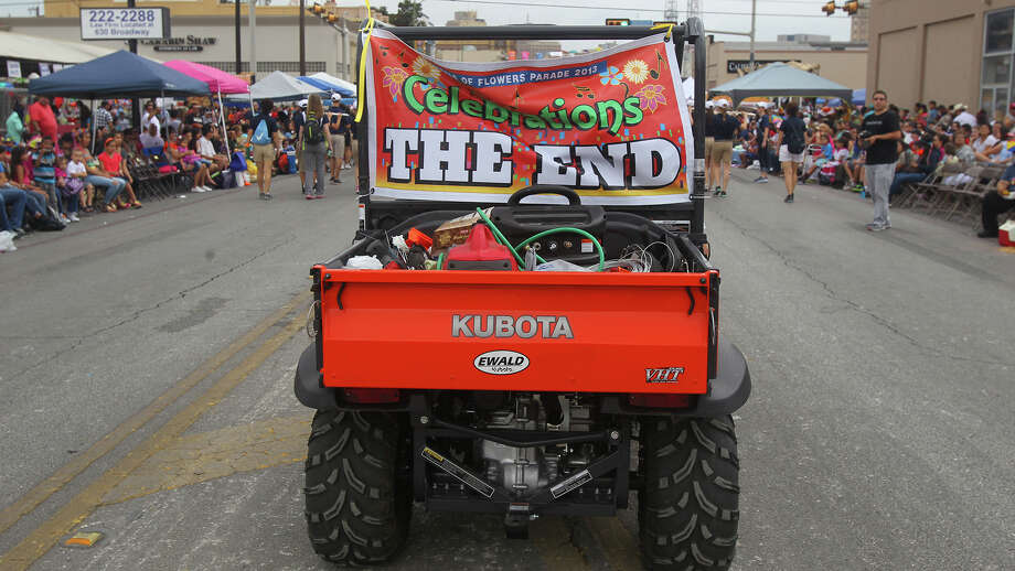 An all terrain vehicle on Broadway marks the end of the 2013 Battle of Flowers parade. Photo: JOHN DAVENPORT, SAN ANTONIO EXPRESS-NEWS / ©San Antonio Express-News/Photo may be sold to the public