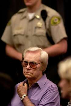 Country singer George Jones listens to Williamson County District Attorney Ron Davis during a court hearing Wednesday, May 12, 1999. Jones pleaded guilty to a drunken driving charge for an accident that nearly killed him last March. Jones was fined $500 on the DWI charge and $50 for the open container violation. The DWI charge does not carry any jail time and Jones will keep his driver's license.   (AP Photo/The Tennessean,Shelley Mays)   HOUCHRON CAPTION (06/09/1999): Singer George Jones sits in a Tennessee courtroom last month during his DWI case. His wrecked SUV is on sale for $22,000.  HOUCHRON CAPTION (01/15/2001):  Jones. Photo: SHELLEY MAYS, MBR / THE TENNESSEAN