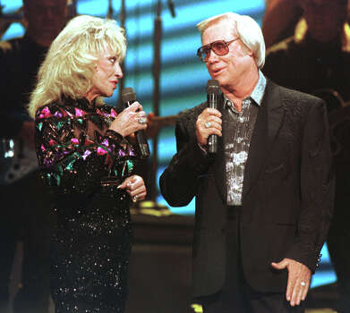 George Jones performs in 1995 with his former wife and duet partner, Tammy Wynette. Photo: CHRISTOPHER BERKEY, STR / AP