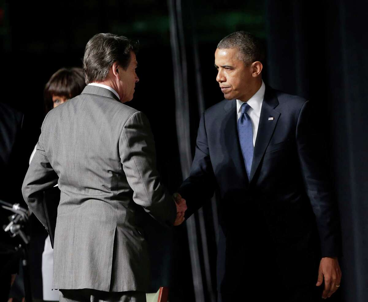 Gov. Rick Perry greets President Obama at a memorial for West firefighters at Baylor University in Waco on Thursday.