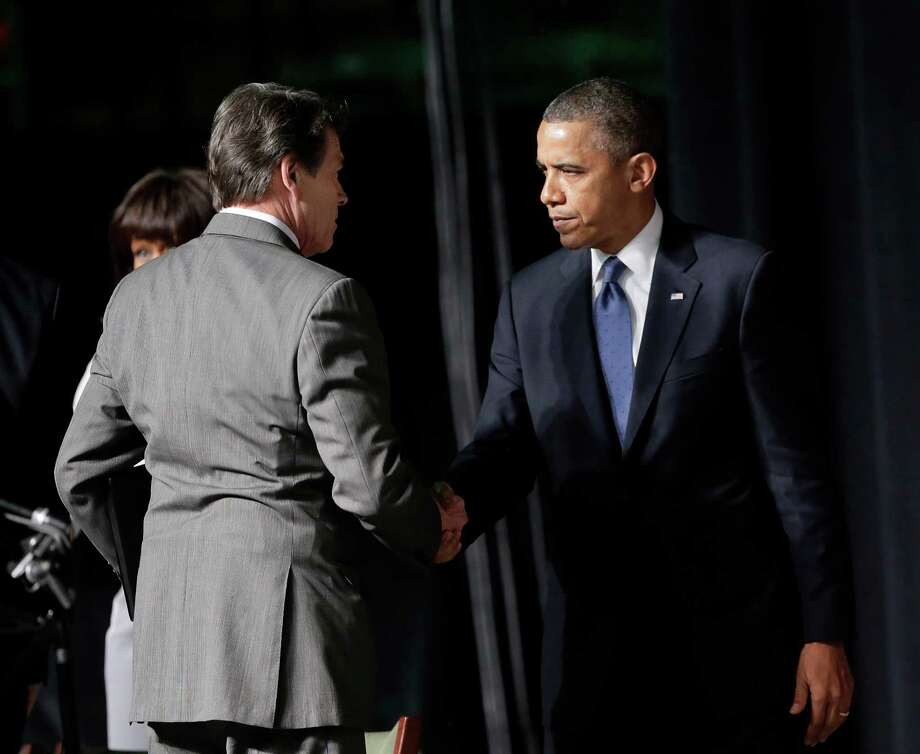 Gov. Rick Perry greets President Obama at a memorial for West firefighters at Baylor University in Waco on Thursday. Photo: Eric Gay, Associated Press / AP