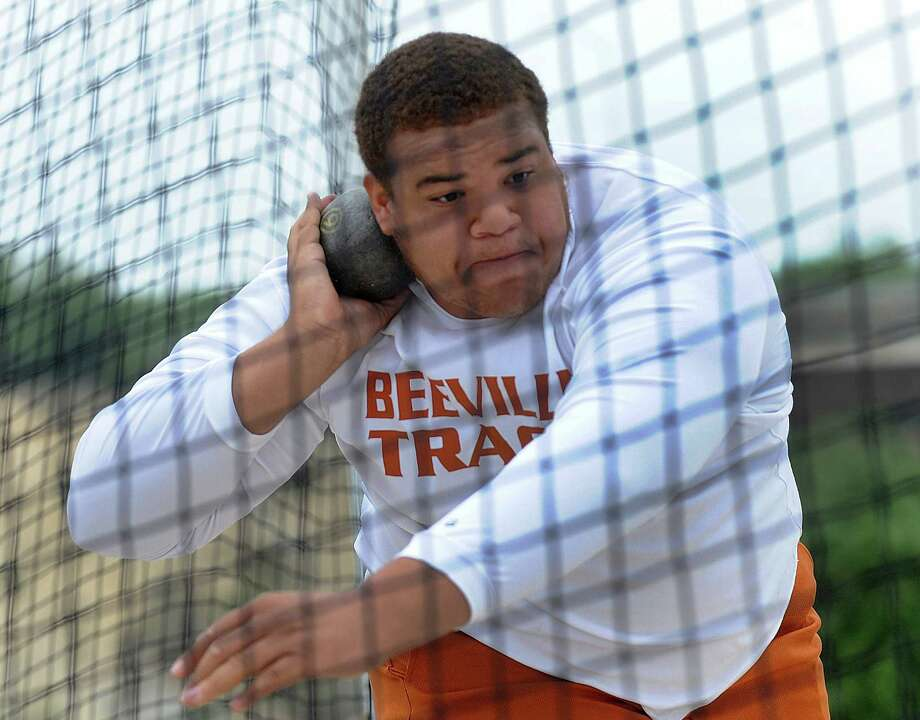 Tevin Wilson of Beeville throws the shot put during the Region IV-4A/5A track meet at Heroes Stadium on Friday, April 26, 2013. Photo: Billy Calzada, Express-News / San Antonio Express-News