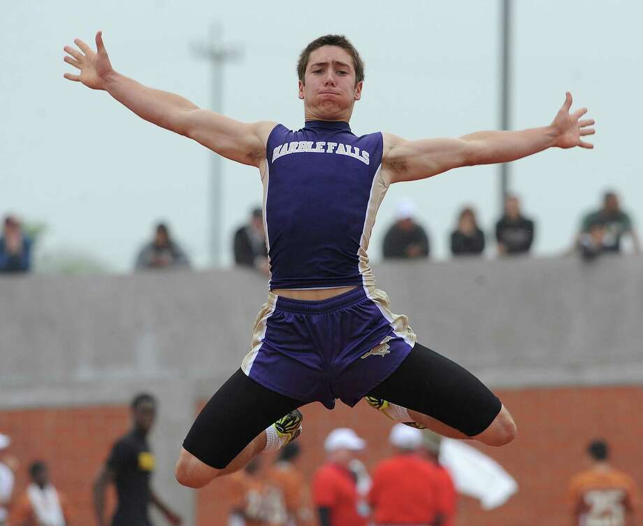 Carson Bowen of Marble Falls participates in the 4A long jump during the Region IV-4A/5A track meet at Heroes Stadium on Friday, April 26, 2013. Photo: Billy Calzada, Express-News / San Antonio Express-News