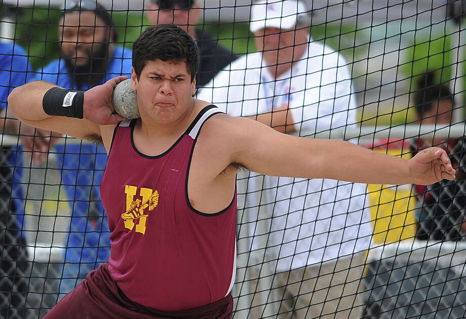 Andres Garcia of Harlandale throws the shot put during the Region IV-4A/5A track meet at Heroes Stadium on Friday, April 26, 2013. Photo: Billy Calzada, Express-News / San Antonio Express-News