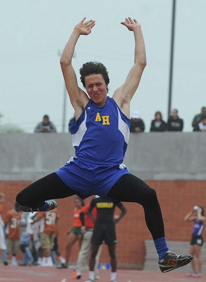 Paul Hernandez of Alamo Heights competes in the men's 4A long jump during the Region IV-4A/5A track meet at Heroes Stadium on Friday, April 26, 2013. Photo: Billy Calzada, Express-News / San Antonio Express-News