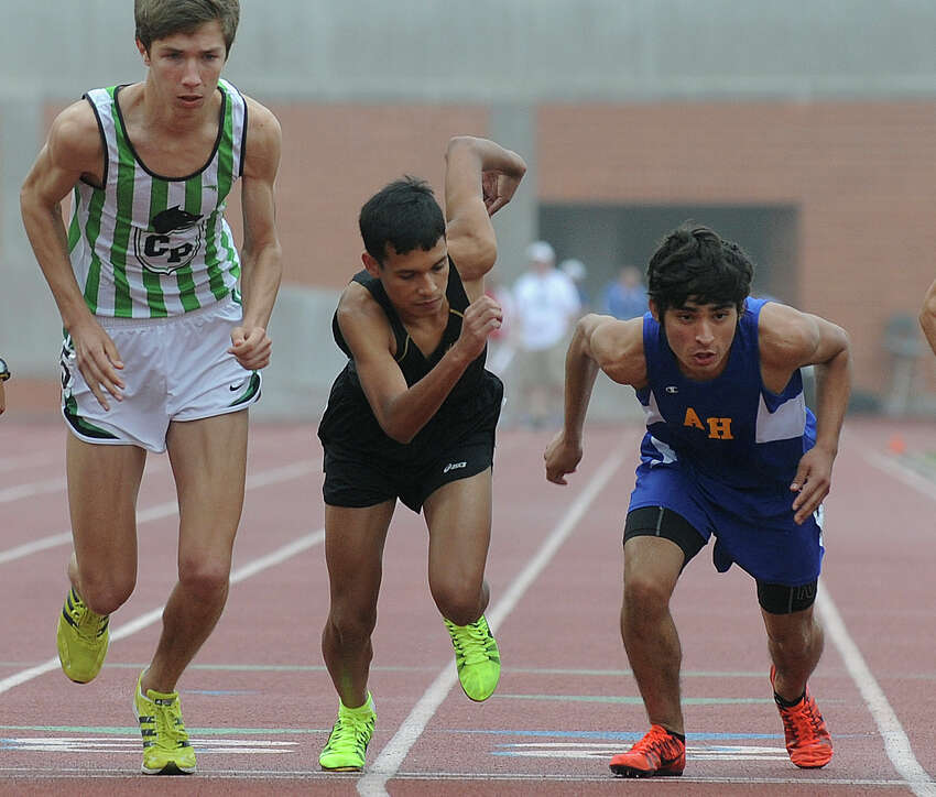 Chris Mulverhill, left, of Cedar Park, Julian Castellano of Edison and Josh Torres of Alamo Heights start the men's 3200 meter 4A run during the Region IV-4A/5A track meet at Heroes Stadium on Friday, April 26, 2013.