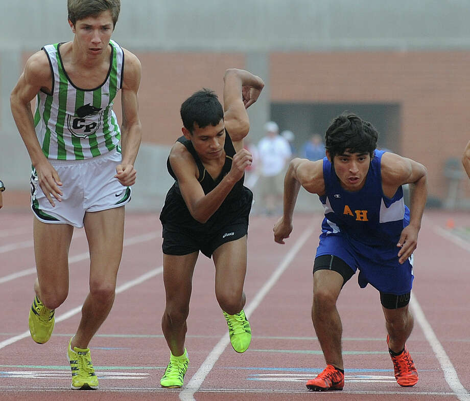 Chris Mulverhill, left, of Cedar Park, Julian Castellano of Edison and Josh Torres of Alamo Heights start the men's 3200 meter 4A run during the Region IV-4A/5A track meet at Heroes Stadium on Friday, April 26, 2013. Photo: Billy Calzada, Express-News / San Antonio Express-News