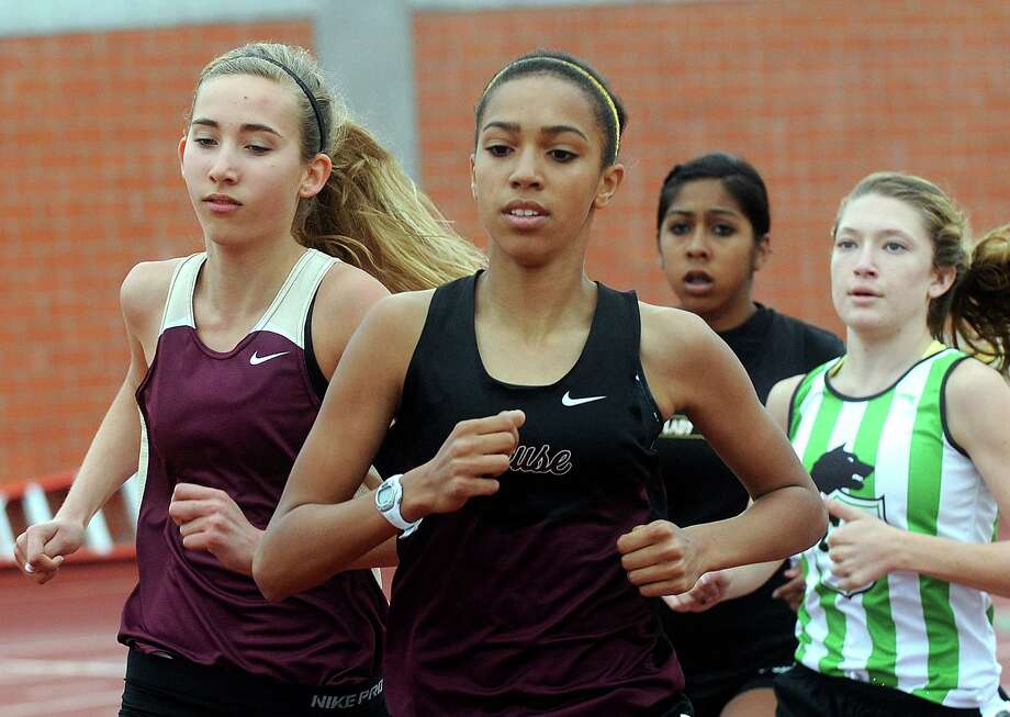 Madie Boreman runs enroute to victory in the women's 3200 meter 4A run during the Region IV-4A/5A track meet at Heroes Stadium on Friday, April 26, 2013. Photo: Billy Calzada, Express-News / San Antonio Express-News