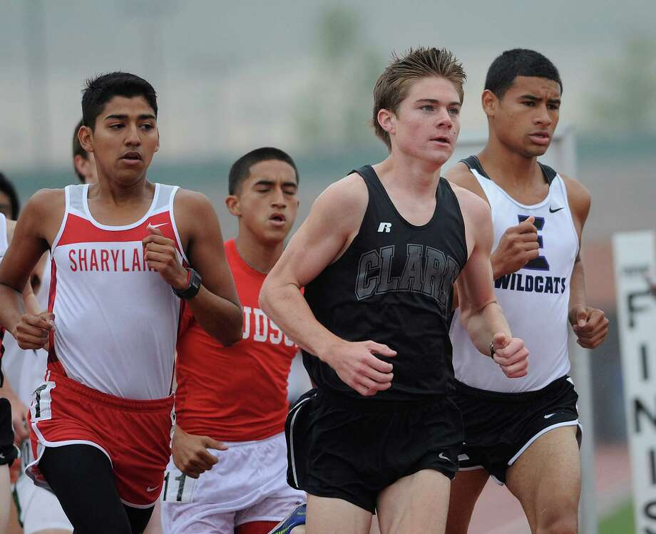 Austin Wells of Clark High School leads the pack in the men's 3200 meter 5A run during the Region IV-4A/5A track meet at Heroes Stadium on Friday, April 26, 2013. Photo: Billy Calzada, Express-News / San Antonio Express-News