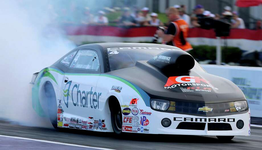 4/26/13:  Pro Stock driver, Erica Enders-Stevens does a burn out before her second qualifying run of the day on the first day of qualifying at Royal Purple Speedway in Baytown, Texas. Photo: Thomas B. Shea, For The Chronicle / © 2013 Thomas B. Shea