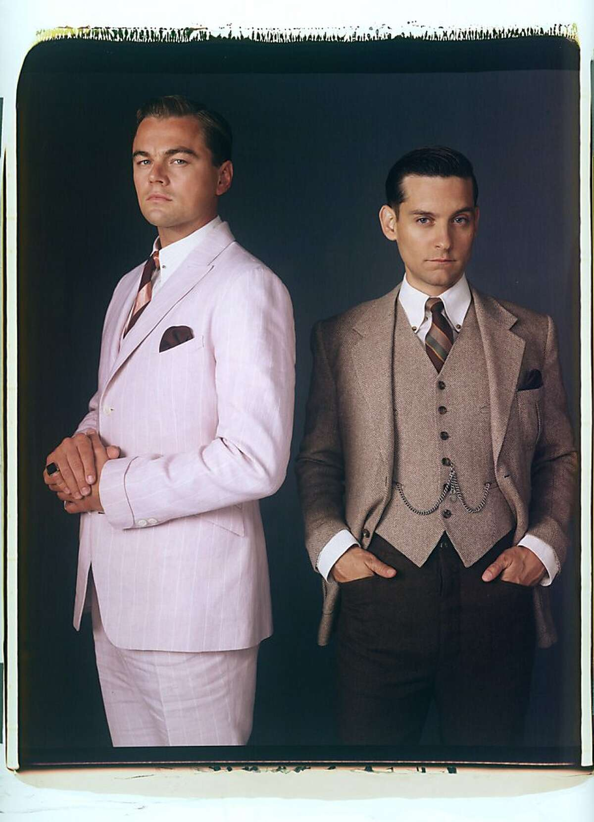 (L-r) Leonardo DiCaprio as Jay Gatsby and Tobey Maguire as Nick Carraway in Warner Bros. Pictures' and Village Roadshow Pictures' drama