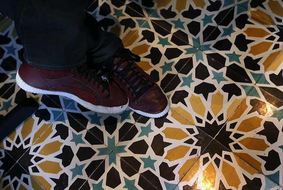 "Straight from the source: ""All over Mexico, you find beautiful cement tiles,"" says Joe Hargrave, who put them in the Palo Alto location. ""They age, crack and look great. We finally found a woman in Alabama who imports them from Dolores Hidalgo, in Guanajuato. We custom-designed them. At our Valencia Street location, they have faded and cracked ...  and look amazing."" Photo: Paul Chinn, The Chronicle"