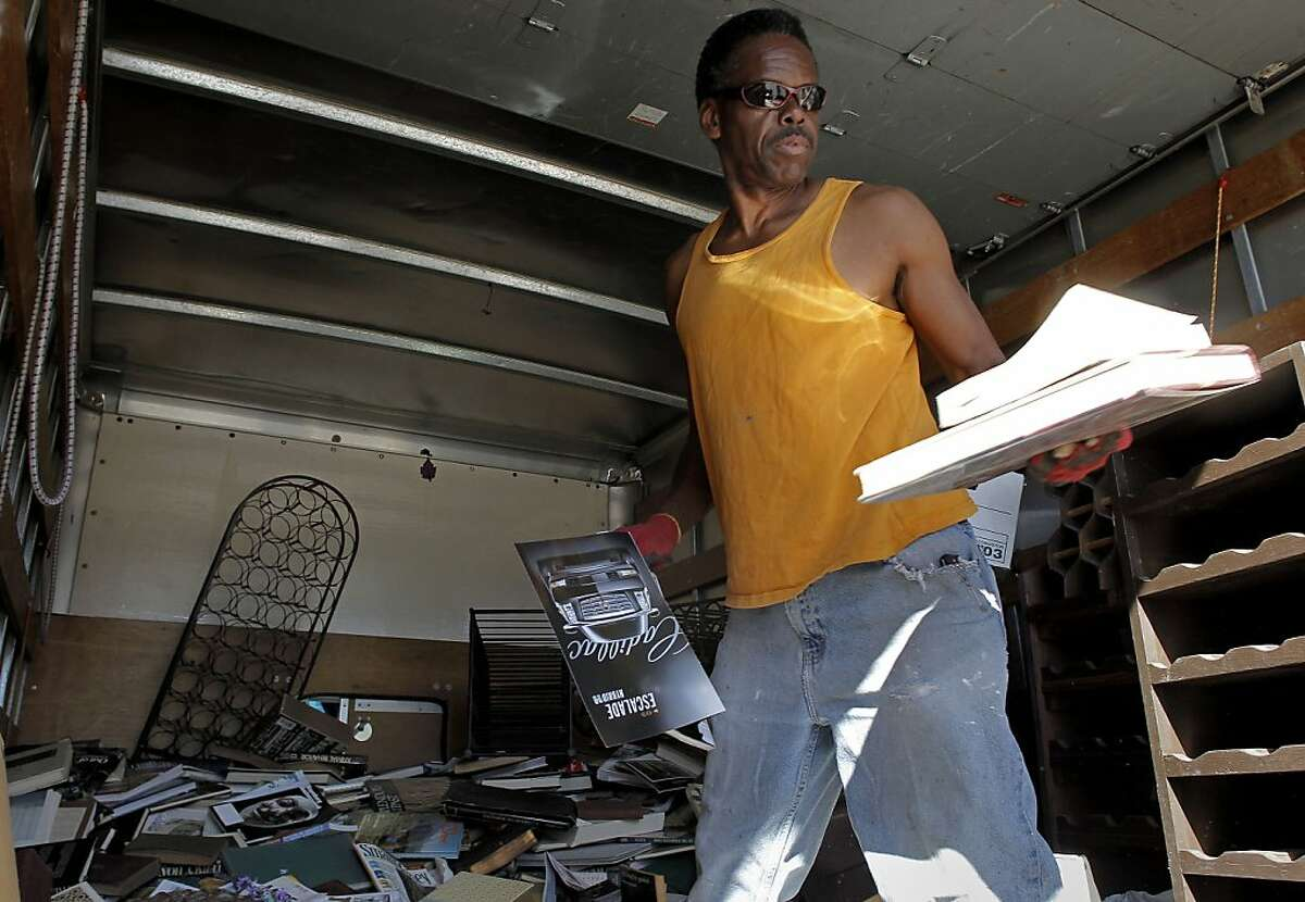 Dennis Gray, who works for a staging company, unloads a supply of books along Shattuck Ave. on Tuesday April 23, 2013, in Berkeley, Ca. Gray said he thinks the raising of the minimum wage is a good idea. The City of Berkeley is considering raising the minimum wage from $8 to $10.55 an hour.
